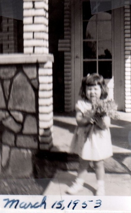 Pam and flowers 1953